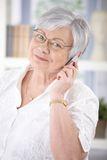 cheerful-senior-woman-talking-mobile-smiling-looking-camera-30529118