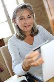 modern-mature-woman-shopping-online-home-senior-doing-33917221