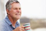 senior-man-drinking-tea-outdoors-21026208